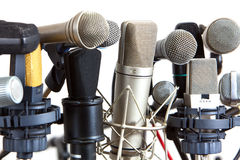 Several kind of conference meeting microphones on white Royalty Free Stock Images