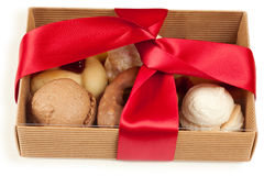 Several kinds of cookies and cakes in open box Stock Images