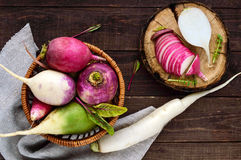 Several kinds of radish daikon, Chinese red, green on a wooden table. Useful vitamins ingredient for salads. The top view Royalty Free Stock Photography