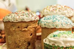 Several Kulich, a traditional Russian Easter bread, with meringu. Several Kulich, a traditional Russian Easter bread with meringue and colorful sprinkles Royalty Free Stock Photography
