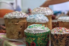 Several Kulich, a traditional Russian Easter bread, with meringu. Several Kulich, a traditional Russian Easter bread with meringue and colorful sprinkles Stock Images