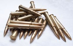 Large caliber rifle bullets on a white background stock images