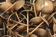 Several large copper nails Royalty Free Stock Photo