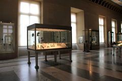 Several large glass cases with Greek artifacts,The Louvre,Paris,France,2016 Royalty Free Stock Image