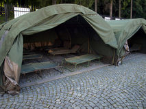 Several large military tents on the paved area Royalty Free Stock Photo