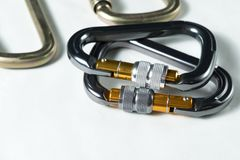 Several large professional aluminum and steel carabiners for climbing Stock Photo