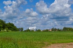 Several large satellite communication antennas in a field against a blue sky. Space Communication Center.  Stock Image