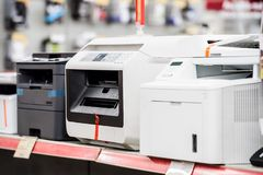 Fiew laser printers in electronic computer store royalty free stock photos