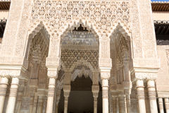 Several layers of arches. Alhambra palace located in Granada (Spain) is a master pice of the Islamic/Muslim Architecture in Europe Stock Photo