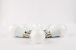 Several LED energy saving light bulbs over the old incandescent, use of economical and environmentally friendly light Royalty Free Stock Photo