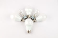 Several LED energy saving light bulbs over the old incandescent, use of economical and environmentally friendly light Stock Photo
