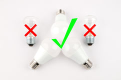 Several LED energy saving light bulbs over the old incandescent, use of economical and environmentally friendly light Stock Photos