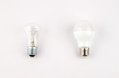 Several LED energy saving light bulbs over the old incandescent, use of economical and environmentally friendly light Stock Photography