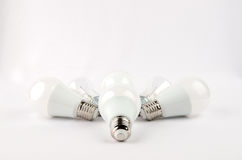 Several LED energy saving light bulbs over the old incandescent, use of economical and environmentally friendly light Stock Images