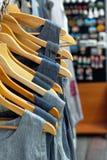 Several linen dresses on hangers Stock Image