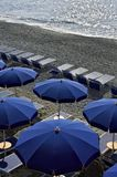 Umbrellas and chairs on a beach. stock images