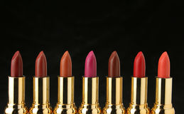 Several lipsticks for make up Stock Photos