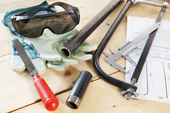 Several locksmith working tools on the wooden workbench Royalty Free Stock Images