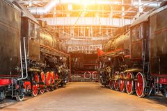 Several locomotives old steam vintage the railroad depot on repair maintenance service. Several locomotives old steam vintage the railroad depot on repair royalty free stock photo