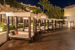 Several of luxury loungers at night illumination, Egypt. Royalty Free Stock Photo