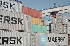 Maersk containers on docks. Several Maersk containers stacked on docks in piles Royalty Free Stock Photo