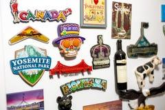 Tourism magnets on the fridge stock photos