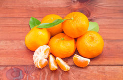 Several mandarin oranges on a dark wooden surface Stock Photography