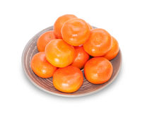 Several mandarins on brown plate isolated Royalty Free Stock Image
