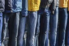 Several mannequins dressed in winter jackets and jeans Stock Photo