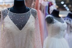 9bcd325f4 Several mannequins with wedding dresses. Are in the showroom stock image