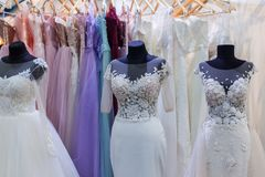 99947b14d Several mannequins with wedding dresses. Are in the showroom stock photo
