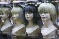Several mannequins with wigs on display Royalty Free Stock Photo