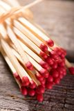 Several matchsticks with red heads bonded by straw Stock Photos