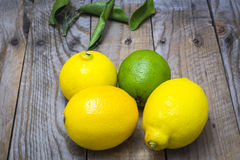 Several mature citrus on an old wooden table Royalty Free Stock Photo