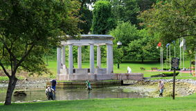 Several men cleaning up the waters in Congress Park,Saratoga Springs,New York,June,2013 Stock Photography