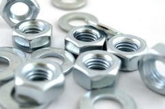 Several metal screw washers and nuts Stock Image