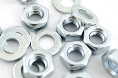 Several metal screw washers and nuts Royalty Free Stock Photo