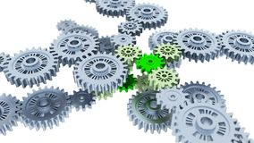Several Metallic Gears with Focus on Some Green Pieces. With a white background Royalty Free Stock Images