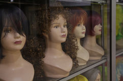 Several minivans in wigs on display Royalty Free Stock Images