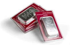 Several minted silver bars in transparent blister pack produced by the Swiss factory Argor-Heraeus stock image