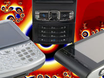 Several Modern Mobile Phones with Psychedelic Royalty Free Stock Photography