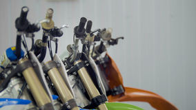 Several motorcycle in the garage - handlebars of enduro cross motorbike Royalty Free Stock Photos