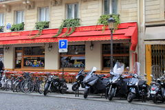 Several motorcycles lined up in front of restaurant,Paris,France,2016 Royalty Free Stock Image