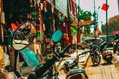 Several motorcycles parked on a street in India stock images