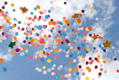 Several multi-colored balloons. Multi-coloured balloons depart to the sky. Holiday Royalty Free Stock Image