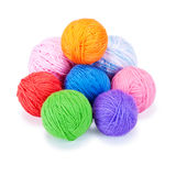 Several multi-colored woolen balls. On a white background Royalty Free Stock Photography
