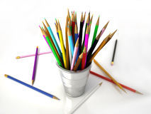 Several Multicolored pencils in a metallic jar. Royalty Free Stock Image
