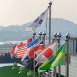 Several National flags on flag poles stock image