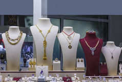 Several necklaces on jewellery showcase in window Royalty Free Stock Photography