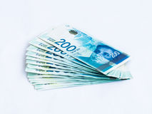 Several new banknotes worth 200 Israeli new shekels on a white background royalty free stock photography